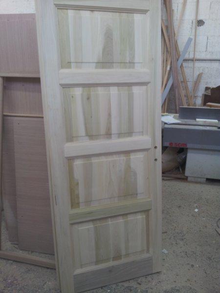 Porta in legno massello di toulipier 4 bugne bianca for Persiane in legno grezze